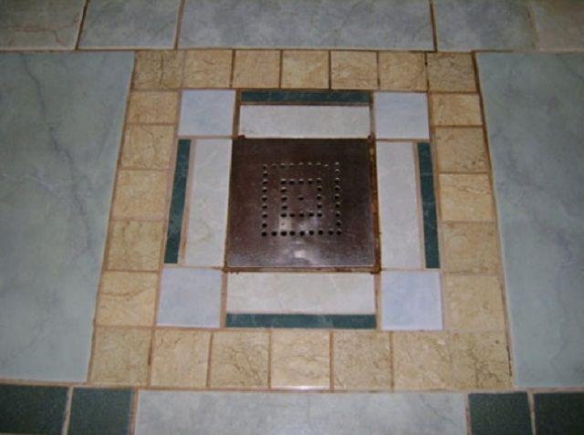 Водосборный трап, отделанный керамической плиткой