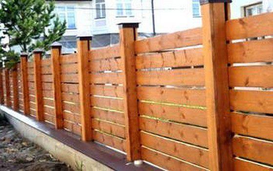 Деревянный забор оригинальной формы