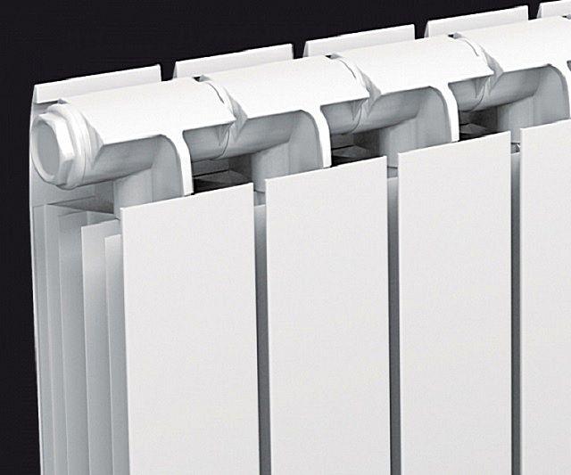 Неразборный радиатор из секций, изготовленных по технологии экструзии