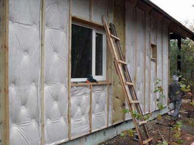 Утеплительные работы на фасадной стороне стен