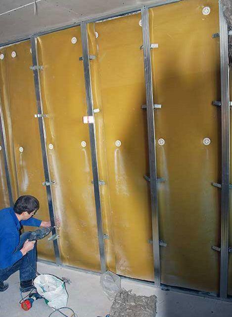 Монтаж металлического каркаса поверх полотен шуиоизоляора