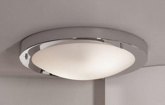 Накладной светильник обычно размещают на потолке или на стене