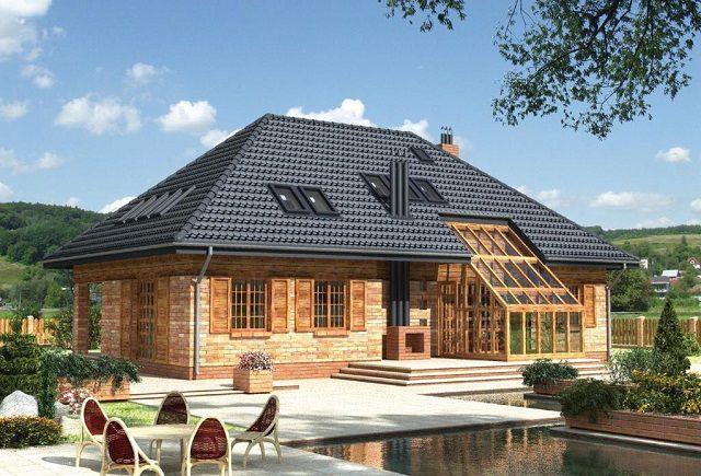 Очень оригинальный вид зданию придают вальмовые крыши