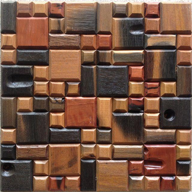 Мозаичная панель собрана из множества небольших прямоугольных рельефных фрагментов, затонированных в разные цвета