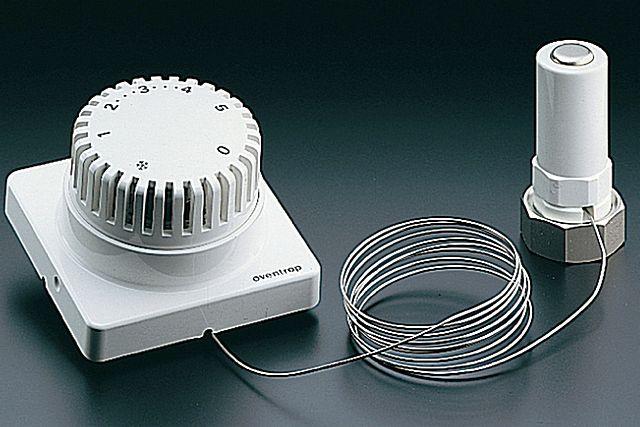 Термоголовка играет только лишь роль привода, а управление осуществляется на выносном блоке