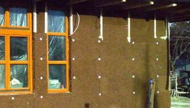 Утепление фасада каркасного дома плитами из черного пробкового агломерата