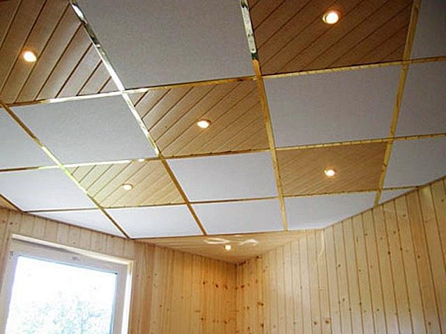 Потолок подвесной кассетного типа. Примерно одинаковая конструкция каркаса,а вот панели могут использоваться самые разные.