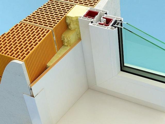 А в этом варианте переход от откоса к поверхности стены закрыт простым уголковым профилем