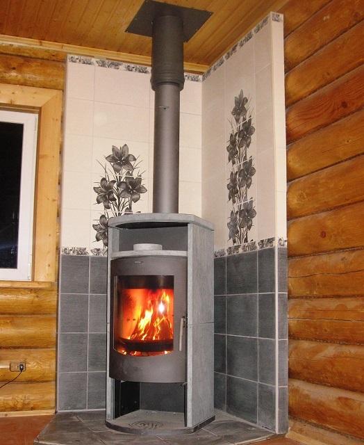 Место установки печи в обязательно порядке оборудуют так, чтобы исключить возможность возгорания пола, потока, стен