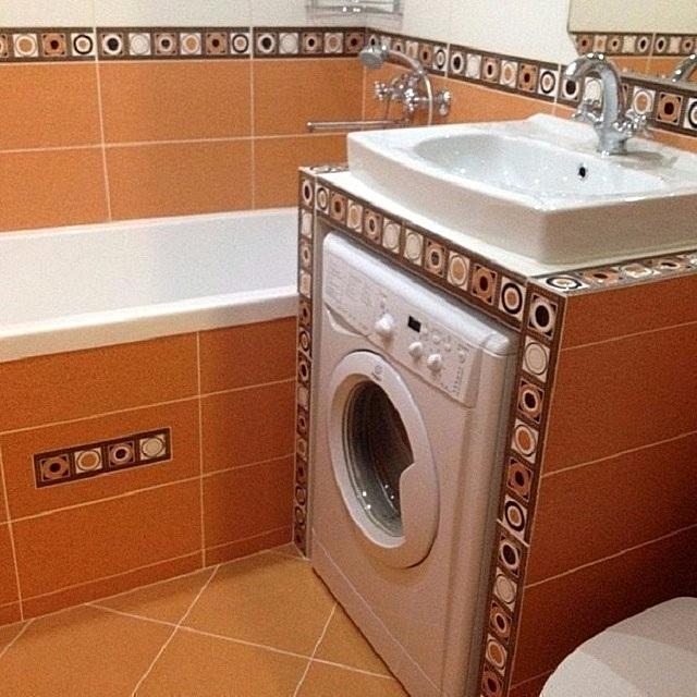 Раковина, установленная поверх шкафа-ниши для стиральной машины