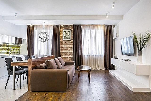 Оригинальная конструкция дивана, задняя стека которого становится опорой для обеденной столешницы