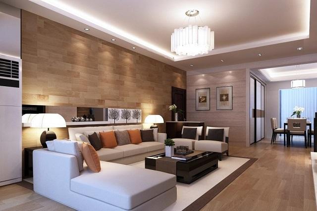 На показанном примере хорошо выделяется обеденная зона (на дальнем плане), в которой организовано отдельное локальное освещение. Установлены и оригинальные светильники с обеих сторон просторного дивана.