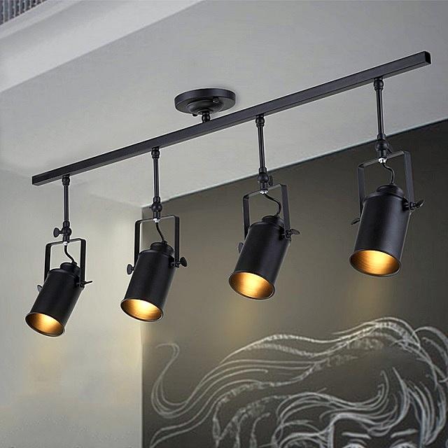 Светильники-споты на шинах, используемые в стилях минимализма.