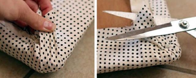 Обивка угла панели – часто здесь требуется и ручное вмешательство, например, прихватывание складок плотной ткани стежками.