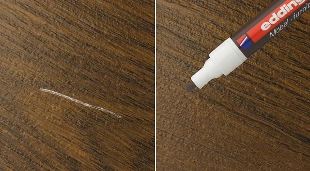 Для маскировки царапин хорошо подойдет реставрационный маркер необходимого цвета.