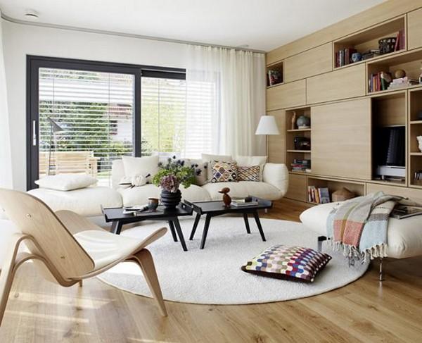 Пример круговой расстановки мебели в гостиной. Здесь обязательно есть центральный элемент – чаще всего это журнальный столик
