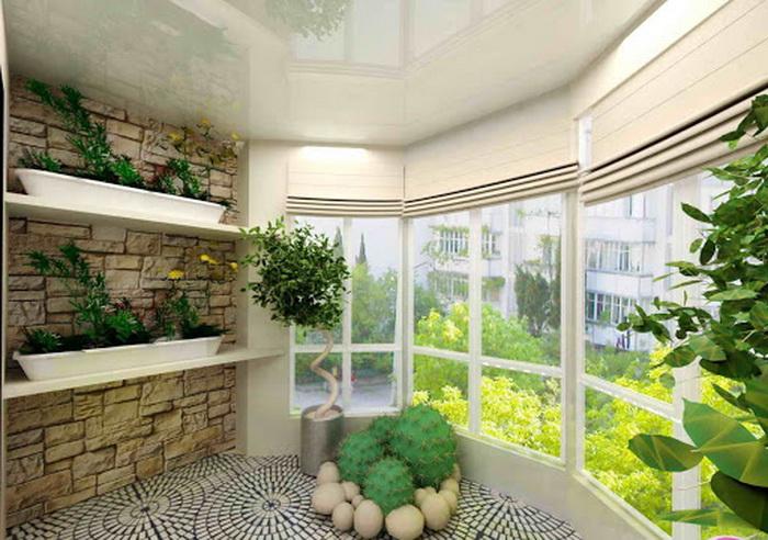 Стена из искусственного камня идеально сочетается с зелеными растениями