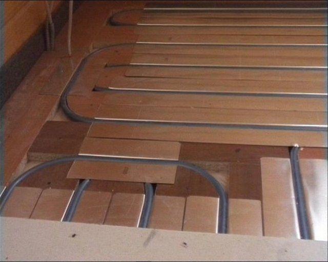 """Укладка труб """"теплого пола"""" в деревянные модули"""