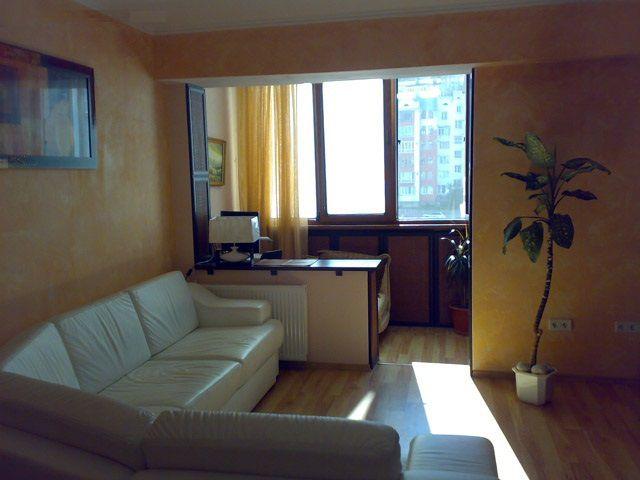 При хорошем утеплении комнату можно объединить с балконом