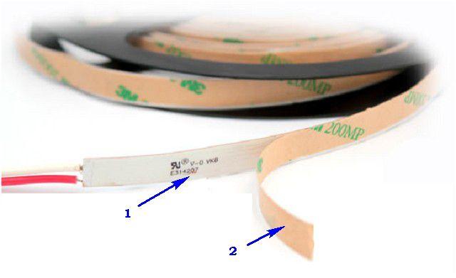 Двусторонний скотч (поз. 1) и защитная подложка (поз. 2), которую снимают при установке ленты