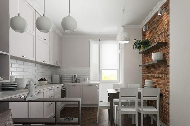 Два типа плитки четко делят кухню на рабочую и обеденную зону. В итоге – чрезвычайно уютное помещение